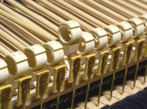 The Cristofori fortepiano appears at first glance to be an Italian harpsichord, but the action inside is quite different … hammers with glued paper cylinders
